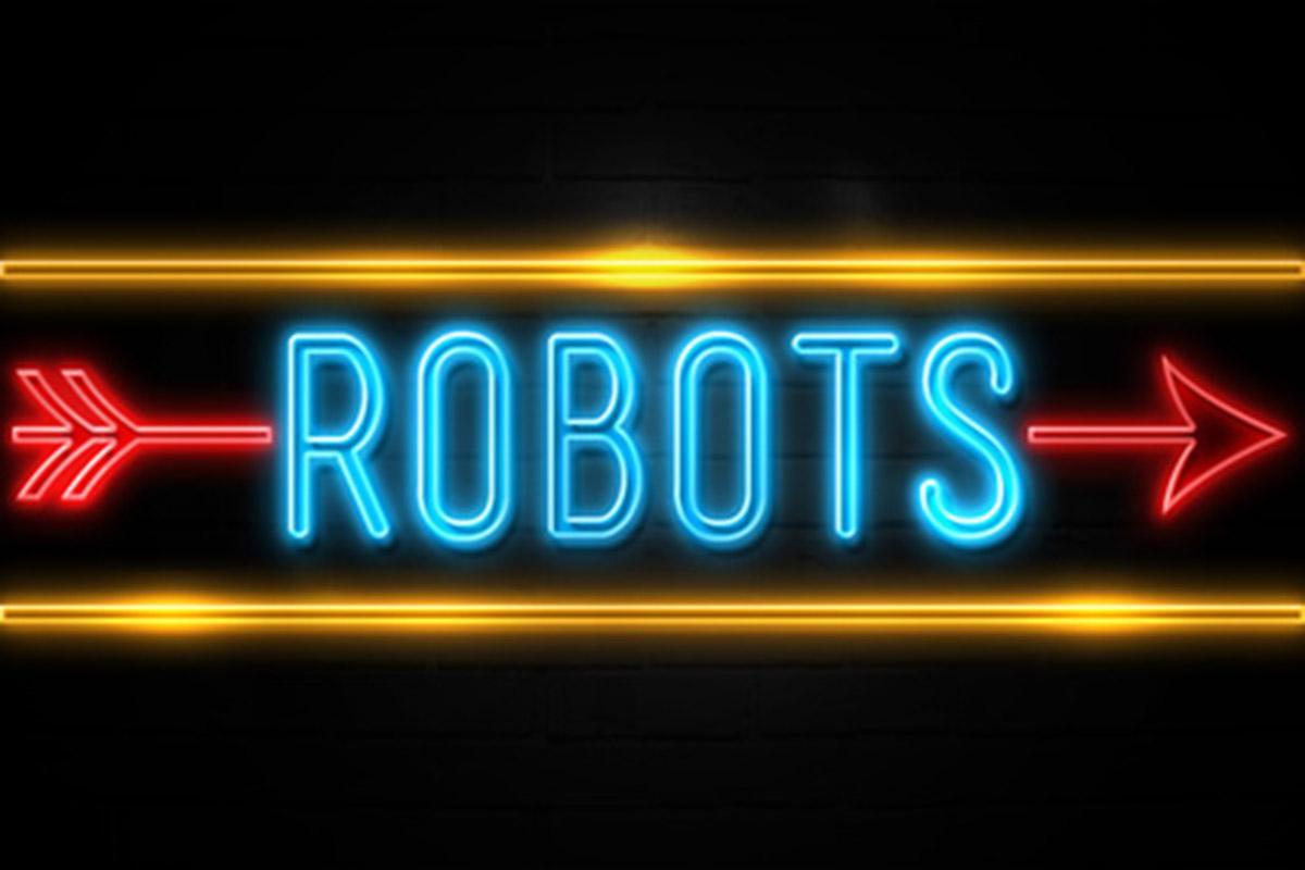 Un néon indiquant la direction vers les robots